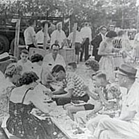 Diners enjoying chicken dinner at an early Chicken Fry