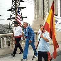 Los Pobladores 200 members Charles Sepulveda, Joseph Northrop, and Robert Smith lead walkers across bridge over the Los Angeles River, September 4, 1999