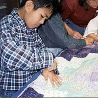 Tracy third-graders working on quilt
