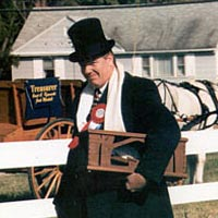 Mayor Joe Booth of Georgetown carrying the ceremonial hatchet, 1996