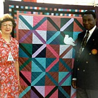 Representative from Uganda being presented with an Olympic Quilt, 1996