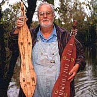 Appalachian dulcimer-maker Tom Hicks showing 2 of his dulcimers at Prater's Mill Fair
