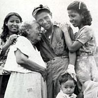 Manuel Perez, USN, returns to family as part of U.S. liberation forces, August 1944