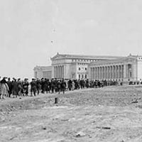 Opening day at Field Museum, with crowds coming from train station, 1921