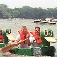 Boats racing in America's Cardboard Cup Regatta