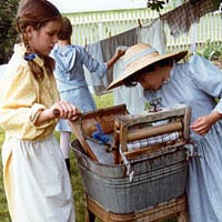 Junior historic interpreters wash clothes