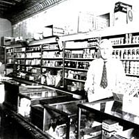 Bill Miller in his grocery store in Hazel, 1939