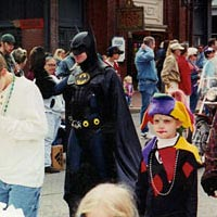Michael Deering dressed as Batman in Mardi Gras parade, 1999