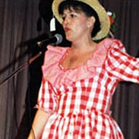 Beverly Calvert spoofs Minnie Pearl during 1999 Festival
