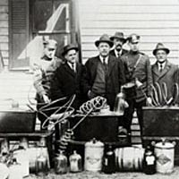 Sheriff John N. Farlaw and his men with confiscated still, ca. 1922, Salisbury, MD