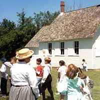 Students and teachers in period dress visit Newburg School, Livonia Historical Village, May 1999