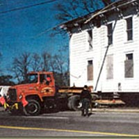 Foster Farmhouse being moved, May 21, 1997
