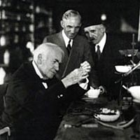Thomas Edison re-enacts his invention of the electric light bulb as Henry Ford looks on, October 21, 1929