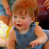 Gage Balkema competes in the Baby Crawl Competition, July 24, 1999
