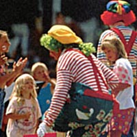 Scene from Cherry Festival with clowns and kids