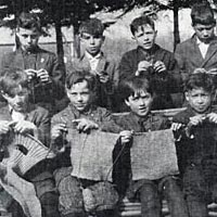 Children from St. Benedict's Mission School knit for Red Cross during World War I, 1916