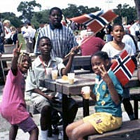 Neighborhood kids mug the camera during Constitution Day celebration, May 17, 1999