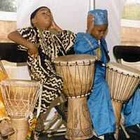 Harambee Youth Drummers perform traditional African movements during drum presentation