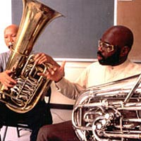 James Jenkins, Eastern Music Festival faculty member, teaches tuba to student musician