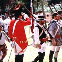Troops pass in review at the end of the battle in Tannenbaum Historic Park