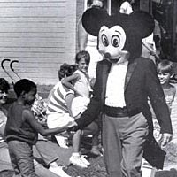 Mickey Mouse greets onlooker at Pumpkin Festival parade