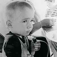 Brandon Baker, age 4, enjoys picnic lunch, August 1999