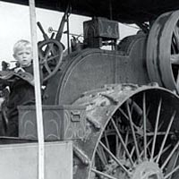 Youngster enjoys sitting on Advance Rumely Steam Traction Engine, October 9, 1999