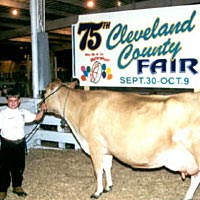 Cameron Lutz with Senior and Grand Champion Jersey Female, October 1999
