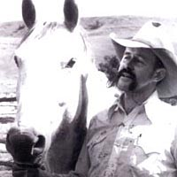 Bill Lowman with his horse, Badger, after branding and vaccinating spring calves, June 1987