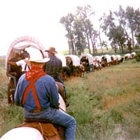 Wagons and riders rounding a bend in the trail near Jamestown, ND, June 1998