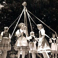 Costumed Czech dancers dance around the Maypole, June 1993
