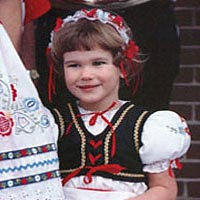 Young girl in Czech outfit greets visitors to Wilber