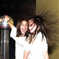 Two girls doing experiment with static electricity at LSC