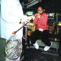 Millville Elementary student blows a glass bubble, 1999