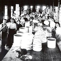 Finished hatboxes are piled high in the Schiffenhaus plant, 1899
