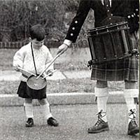 Newest member of Bergen Pipe Band prepares to march in Bergenfield's St. Patrick's Day Parade, 1999