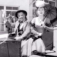 "Actors Milburn Stone and Amanda Blake from the TV western ""Gunsmoke"" at T or C parade in 1953"