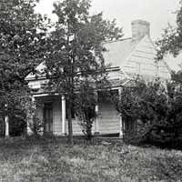 Poe Cottage, with Arthur Stoughton standing on the lawn, 1884