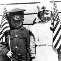Children with American flags, ca. 1920s