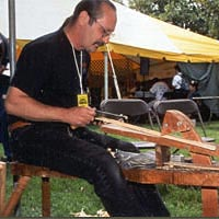 Ike Yakim demonstrates the art of preparing oak splints for basketmaking