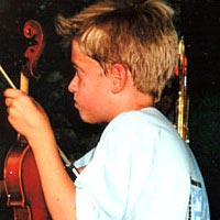 Music camp participant waits to perform with Springfield Symphony Orchestra, June 1999