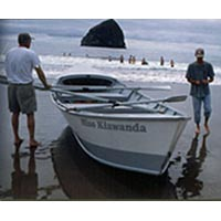 Howard Perkins and son with their traditional dory, Miss Kiwanda, July 1999