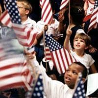 Kids wave flags at Library Day