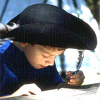 Boy practices 18th-century writing at FestiFall