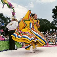 Costumed dancer performs at 1999 Fiesta
