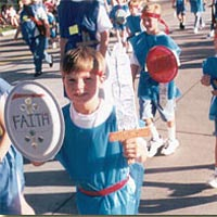 Costumed children march in Grand Parade