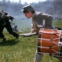 Confederate drummer boy in reenactment of 1862 battle