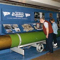 Visitors visit exhibit on Torpedo Factory's history
