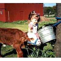 Tessa Dolan with Elwood the calf, April 1999