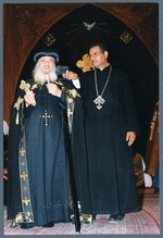 [His Holiness Pope Shenouda III chanting into tape recorder at Ragheb Moftah's funeral], June 18, 2001 [photograph]